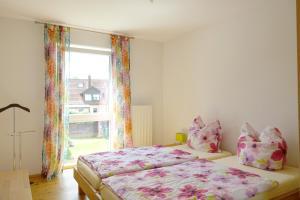 Ein Bett oder Betten in einem Zimmer der Unterkunft Haag Ferienwohnungen