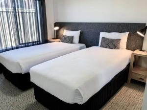 A bed or beds in a room at Quest Sale