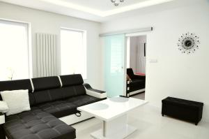 A seating area at Apartament Pegaz
