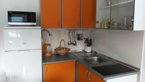 A kitchen or kitchenette at Apartments Timbar