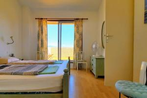 A bed or beds in a room at Villa in Theoule with a Gorgeous Sea View