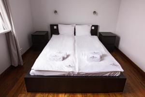 Apartments Grzybowska by City Quality 객실 침대