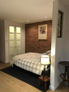 A bed or beds in a room at Historic Harlem Duplex