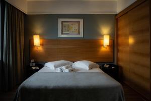Cama ou camas em um quarto em SP Stays Peixoto Gomide