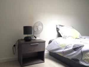 A bed or beds in a room at T1 Bis Lumineux