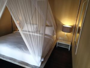A bed or beds in a room at Les Villas Ottalia Gili Meno