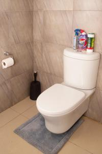 A bathroom at Dede Apartment -A Home Away From Home...