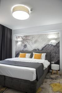 Кровать или кровати в номере WEST RESIDENCE APARTMENTS