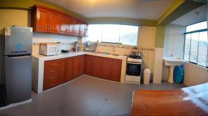 Una cocina o zona de cocina en Villas House
