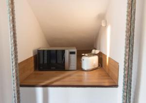 TV o dispositivi per l'intrattenimento presso Suite Maison 1706 Lago Orta