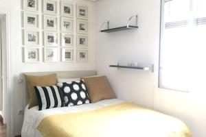 A bed or beds in a room at Apartment Calle de Linneo