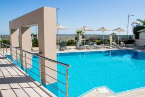The swimming pool at or near Olympic Suites