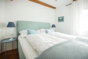 Ein Bett oder Betten in einem Zimmer der Unterkunft Exclusive Apartment Lucio Silla