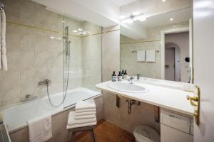 Ein Badezimmer in der Unterkunft Exclusive Apartment Lucio Silla