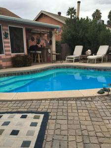 The swimming pool at or near Camelback Cottage