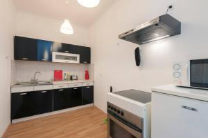Nhà bếp/bếp nhỏ tại Porat Apartments