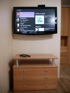 A television and/or entertainment center at Квартира - студия