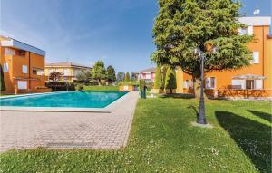 The swimming pool at or near Two-Bedroom Apartment in Lugana di Sirmione BS