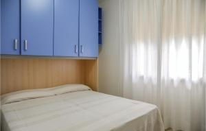 A bed or beds in a room at La Piazzetta 1