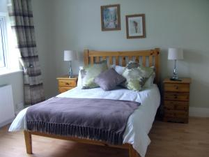 A bed or beds in a room at Cuisle Respite Holiday Centre