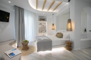 A bed or beds in a room at Mystique of Naxos