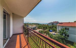 A balcony or terrace at Three-Bedroom Apartment in Kastel Stafilic