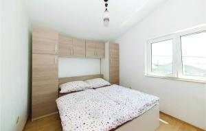 A bed or beds in a room at Three-Bedroom Apartment in Kastel Stafilic