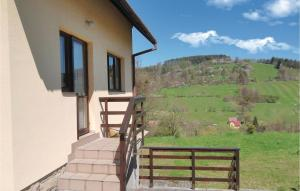 A balcony or terrace at Two-Bedroom Holiday Home in Mala Bystrice