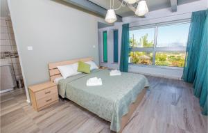 A bed or beds in a room at Three-Bedroom Holiday Home in Argaka