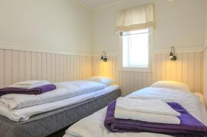Säng eller sängar i ett rum på Vålkojan