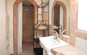 A bathroom at Three-Bedroom Apartment in St-Sebastien d'Aigref.