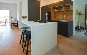 A kitchen or kitchenette at Three-Bedroom Apartment in Koper