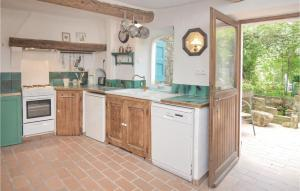A kitchen or kitchenette at Three-Bedroom Apartment in St-Sebastien d'Aigref.