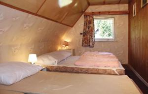 Postel nebo postele na pokoji v ubytování Holiday home Horni Lucany Nr.