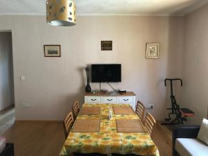 A television and/or entertainment center at Apartments Lamjana