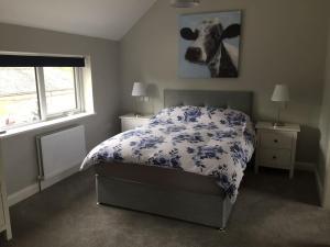 Cama o camas de una habitación en Stoneybridge Lodge