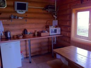 A kitchen or kitchenette at Eglieni
