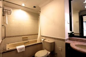 A bathroom at Orange Grove Service Apartment by ST Residences