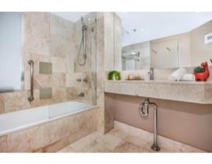 A bathroom at Ocean Vistas And Convenience By The Beach