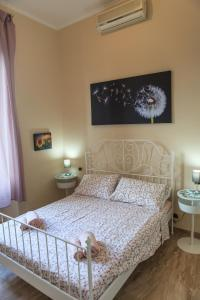 Postel nebo postele na pokoji v ubytování Colosseo Home 161