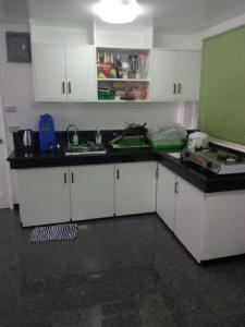 A kitchen or kitchenette at Davimar House