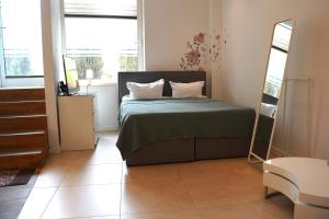 A bed or beds in a room at small luxus apartment