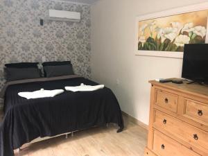 Cama o camas de una habitación en Cabanas Canasvieiras