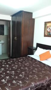 Cama o camas de una habitación en Wasinkayka Aparts & Rooms
