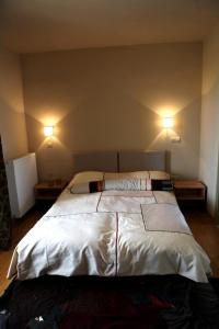 A bed or beds in a room at Plethon Residence