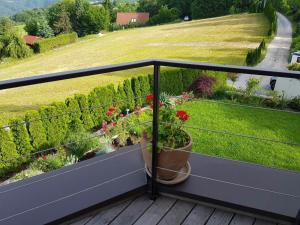 A balcony or terrace at Kriška vas, Gujžina holidays