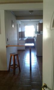 Una cocina o kitchenette en Apart Altos Del Bolson
