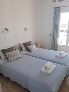 Een bed of bedden in een kamer bij Elizabeth