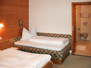 Ein Bett oder Betten in einem Zimmer der Unterkunft Haus Christof 126W
