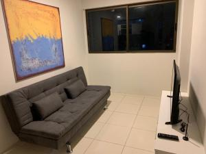 A seating area at Pousada Flat Hotel Bairro Torre em Recife